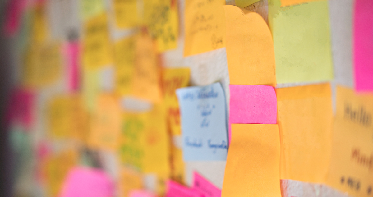 Image of colorful sticky notes on cork bulletin board (Credit: Getty Images/Witthaya Prasongsin)